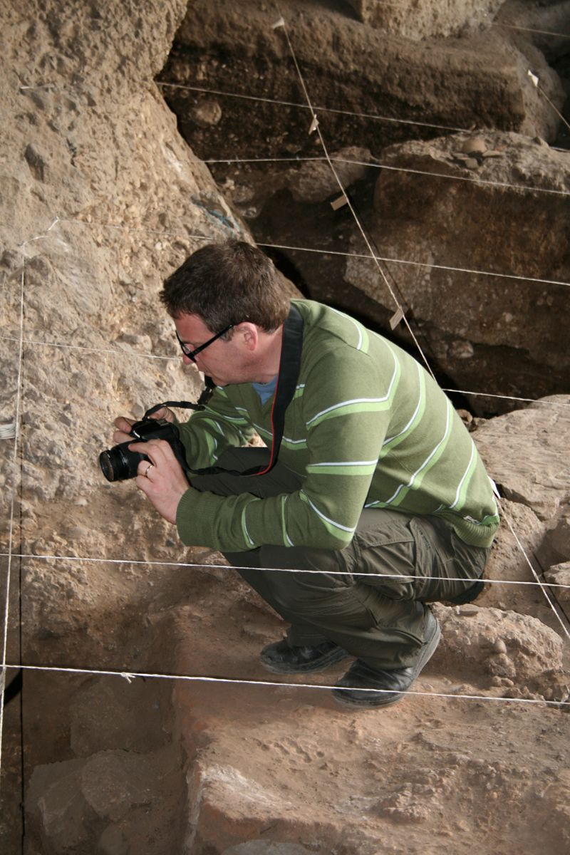 Dr. Ron Pinhasi, University College Cork, investigates one of the pits in the cave